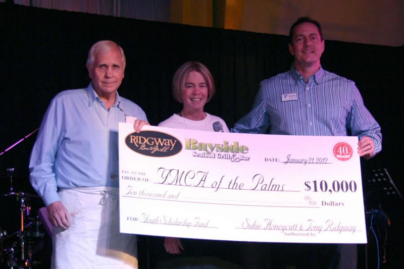 Tony and Sukie Present Charity Check to YMCA